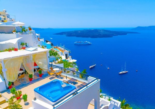 View-to-the-sea-and-Volcano-from-Fira-the-capital-of-Santorini-island-in-Greece-707×500